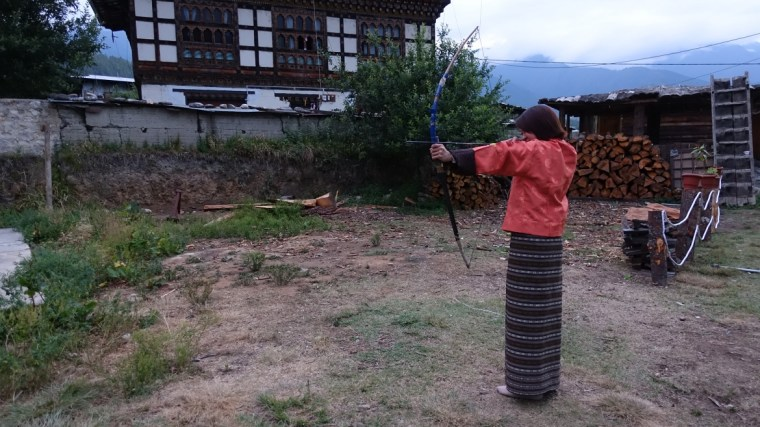 Lydia trying the national sport of Bhutan